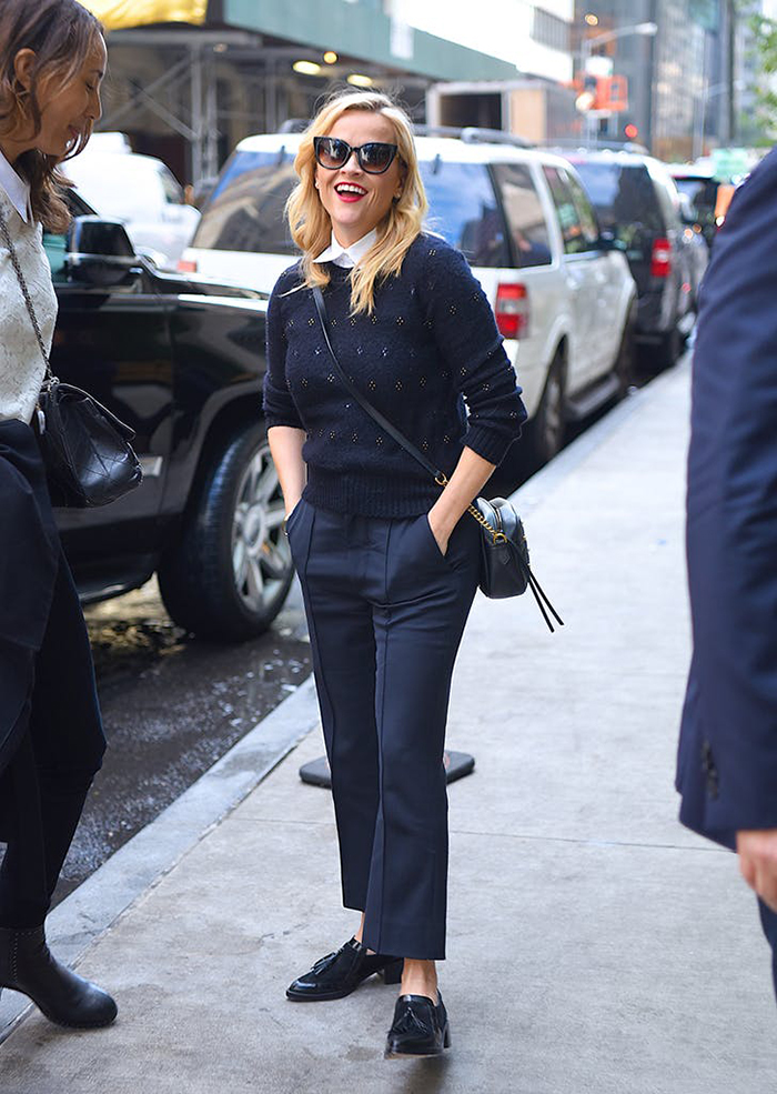 reese-witherspoon-wearing-navy-pants-and-sweater-and-brogues