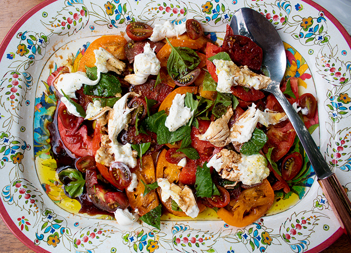 This image has an empty alt attribute; its file name is tomato-burrata-basil-salad-wp.jpg